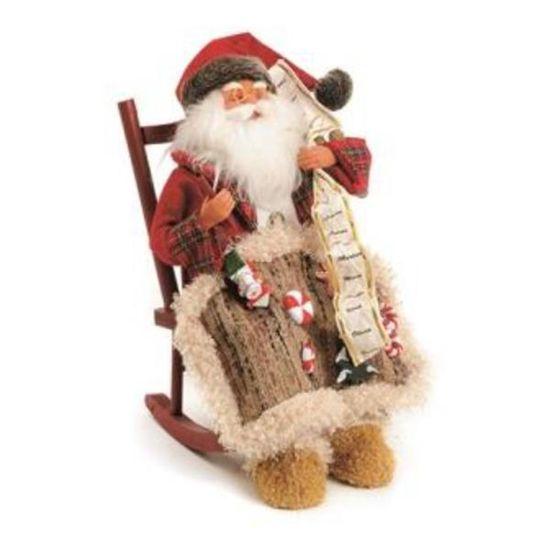 Noel Sentado Segurando Saquinho
